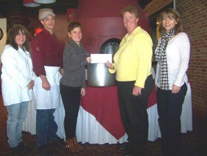 Representatives of the Oswego Lions Club recently presented United Way of Greater Oswego County with a check in the amount of $1,500 in support of United Way's Stone Soup Luncheon. All proceeds from the event, as well as the food that is collected, will be donated to local food pantries.