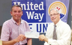 Patrick Dewine, accepts a $5,000 check from Walter Dengos, Community & Customer Manager for National Grid