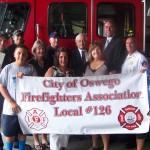 <b>Oswego City Firefighters helps United Way Stuff-A-Bus</b>