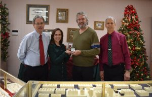 The winning ticket for this year's United Way of Greater Oswego County diamond ring raffle was drawn on Christmas Eve at DuFore Jewelers in Oswego. Pictured from left are Greg DuFore, United Way Resource Development Director Lexie Wallace, raffle winner Bob Dexter, and Mark DuFore. This year's raffle raised a record total of more than $3,200 to support the United Way's Annual Campaign