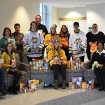 Members of the SUNY Oswego community recently presented the United Way of Greater Oswego County with donations of nonperishable food items and toys collected during the Nov. 30 Men's and Women's ice hockey games. Pictured above are members from both hockey teams, representatives from the SUNY Oswego SEFA United Way Campaign Committee, United Way staff, and representatives from both the Human Concerns Center and Salvation Army of Oswego County, which were the agencies that shared this year's collection. The community is invited to help SUNY Oswego continue giving back by visiting the Dec. 9 Holiday Skate with the Lakers in the Marano Campus Center.