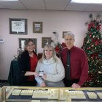 The winning ticket for this year's United Way of Greater Oswego County diamond ring raffle was drawn on Christmas Eve at DuFore Jewelers in Oswego. Pictured from left are United Way Resource Development Director Stacey Morse, raffle winner Jodi Lawton, and Mark DuFore. This year's raffle raised a record total of more than $3,300 to support the United Way's Annual Campaign.